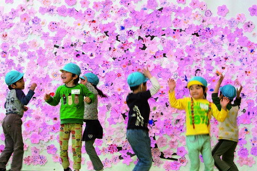 Young nursery school children play in the Red Cross 'Smile Park'- a children's play facility set up to give Fukushima children, whom can't play outdoors due to fears of radiation, somewhere to have fun, in Fukushima city, in Fukushima prefecture, Japan, o
