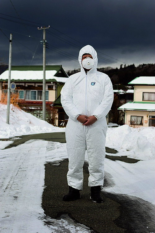Ryuko Ishikawa (39 yrs old), a Buddhist priest whose temple Kannon-ji is situated in Namie town within the Fukushima nuclear exclusion zone, photographed wearing protective clothing in the highly radiated and now evacuated and deserted Iitate village, jus