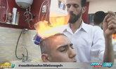ช่างผมอียิปต์อวดทักษะใช้ไฟจัดทรงลูกค้า
