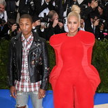 Helen Lasichanh And Pharrell Williams In Comme Des Garcons